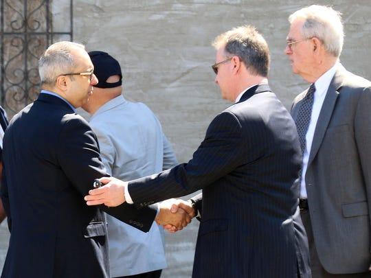 Former Passaic Mayor Alex Blanco with his legal team