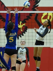 Marian's sophomore setter leaps high in an attempt
