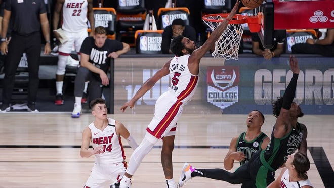 Miami's Derrick Jones Jr. attempts to block a shot attempt by Boston's Marcus Smart, top right, during the second half of Thursday's game.