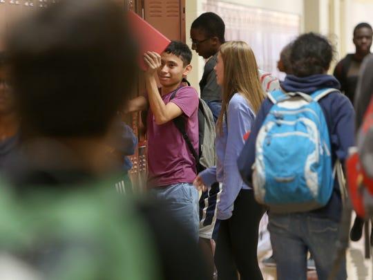 Students fill the halls in between classes at Walnut Hills High School.