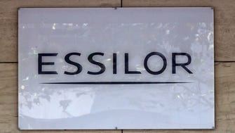 This photo shows the logo of Essilor, a French ophthalmic optics company, in Charenton le Pont, east of Paris. Essilor International SA announced Monday it had reached a share exchange deal with Luxottica's main shareholder Delfin to create a combined company making both frames and lenses.