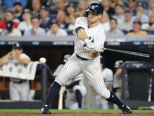 Brett Gardner was able to connect on this pitch and reach first base on an overthrow as Starlin Castro (not shown) was able to score in the third inning, Monday, October 9, 2017.