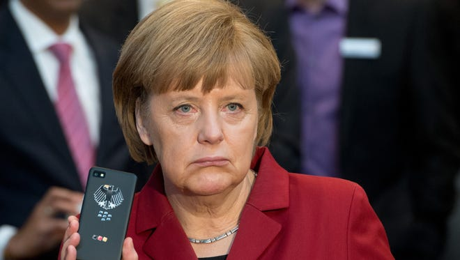German Chancellor Angela Merkel is displeased over reports that the National Security Agency may have collected data on her cellphone use.