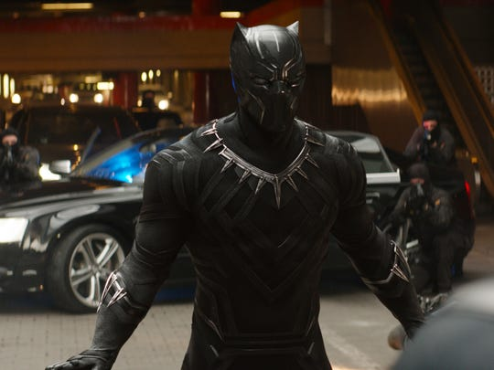 Black Panther (Chadwick Boseman) confronts Captain