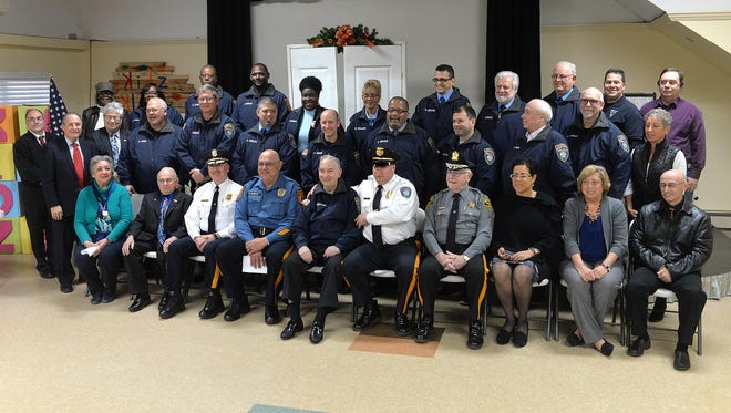 Chaplains and police chiefs from Millville, Bridgeton, and Vineland pose for group photo with officials from Cumberland County, Tuesday, Feb. 2 in Millville.