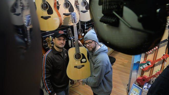 Music Central assistant manager Jeff Weber, 27, and manager Sean Shropshire, 31, both of Vineland inside the Landis Avenue shop Feb. 8 in Vineland.