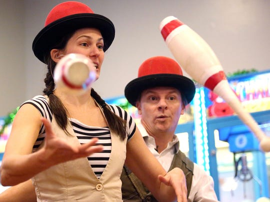 Allison of The Give and Take Jugglers performs at the