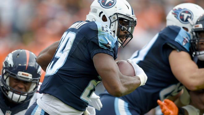 Titans running back DeMarco Murray (29) powers through the Broncos defense.