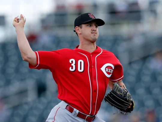 Cincinnati Reds pitcher Tyler Mahle (30) delivers a