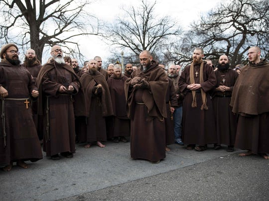 AFP_L5629.jpg The Franciscan Friars Minor gather between The Supreme Court of the United States and The Capitol Building during the 44th annual March for Life January 27, 2017 in Washington, DC.  Anti-abortion advocates descended on the US capital on Friday for an annual march expected to draw the largest crowd in years, with the White House spotlighting the cause and throwing its weight behind the campaign.