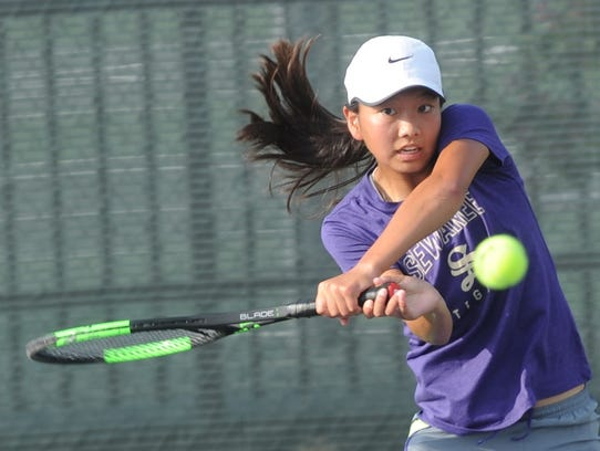 Abilene's Ruth Hill returns a shot in her Girls' 16 Singles consolation match against Austin's Anushka Dania. Dania won 6-1, 6-0 on Wednesday at ACU's Eager Tennis Center.