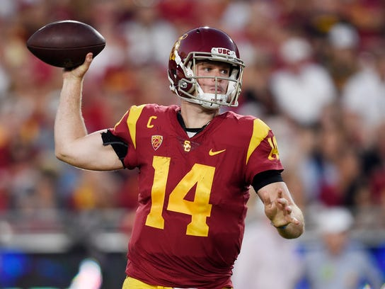 FILE - In this oct. 14, 2017, file photo, Southern California quarterback Sam Darnold passes the ball during the first half of an NCAA college football game against Utah, in Los Angeles. Quarterbacks Sam Darnold, Lamar Jackson and Josh Rosen are among the record 106 underclassmen given special entry to the NFL draft, making it four of the last five seasons in which at least 95 players have declared early. The NFL released Friday, Jan. 19, 2018, the official list of college players who have requested early entry.  (AP Photo/Kelvin Kuo, File)