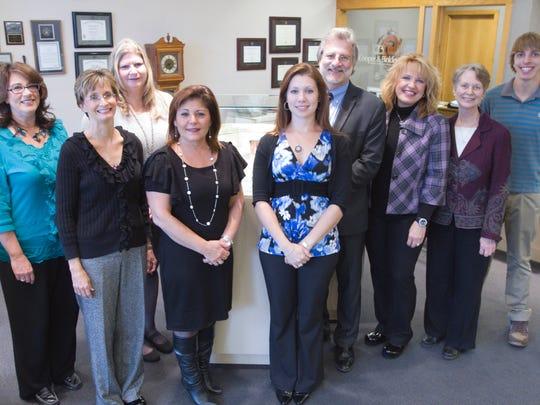 The staff of Cooper & Binkley Diamond Jewelers (from left) are: Debbie Mohr, Kathy Curley, Julie Nowicki, Noreen Masropian, Angela Meeham, Mark Binkley, Barb Binkley, Sandy Hilbert and Tommy Binkley.
