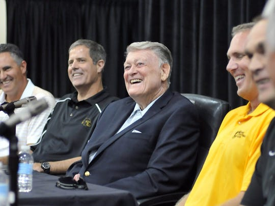 Former University of Iowa football coach Hayden Fry appears with a panel of his former quarterbacks last fall during FRY Fest in Coralville. FRY fest organizers called the coach Friday to wish him happy birthday ahead of 86th birthday on Saturday.
