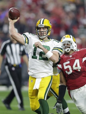 Green Bay Packers quarterback Aaron Rodgers (12) makes a pass in the third quarter against the Arizona Cardinals at University of Phoenix Stadium.
