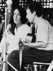 Joan Baez and Bob Dylan sing at the Newport Folk Festival in 1963 in Rhode Island.
