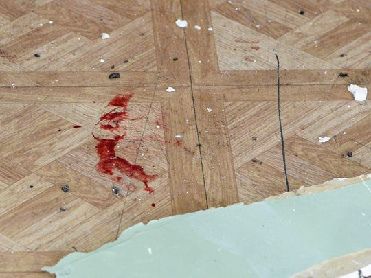 Bloodstains inside the hallway of 86 Main St. in Paterson from a shooting early Sunday.