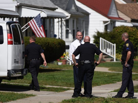 Police investigate at a home where two children were