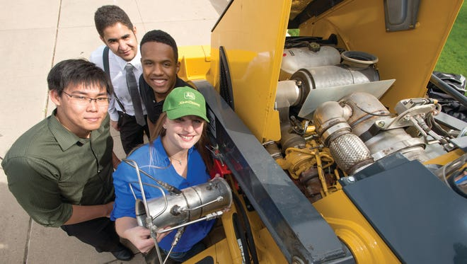 The John Deere Final Tier 4 SCR DEV Diesel Engine Mixing Improvement senior design project by Jennifer Lamb, Stephen Hosana, Ryan Lewis and Mohammed Al Ali at the 2014 E-Day at Moby Arena. April 25, 2014