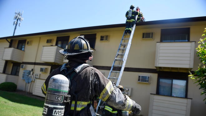 Firefighters work a small fire at Warren House Apartments in South Nashville May 23, 2016 in Nashville, Tenn. There is no visible damage and firefighters put the fire out quickly.