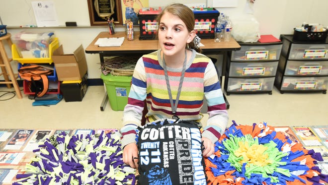 Cotter seventh-grader Kate Cheek talks with her teacher Monica Springfield (off camera) about the upcoming Youth Entrepreneur Showcase (Y.E.S.) for Arkansas Expo day to be held in Little Rock in January. Cheek will set up a booth to display the pillows and rugs she's made from shredded T-shirts.