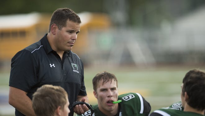 Former Fossil Ridge High School football coach has been hired to the same position at Rock Canyon High School in Highlands Ranch.