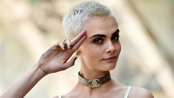 Cara Delevingne is making the most of her new close-cropped haircut.