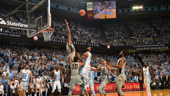 North Carolina guard Joel Berry II hits the game-winning shot over Wake Forest center Doral Moore.