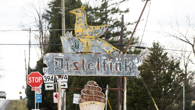 The iconic neon sign in front of Distelfink Drive-In in Straban Township went dark in 2011. The name Distelfink is borrowed from the Pennsylvania Dutch symbol for good fortune, a yellow finch.