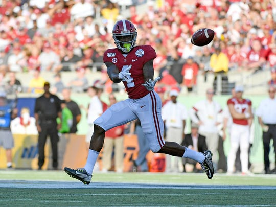 Jan 1, 2020; Orlando, Florida, USA; Alabama Crimson Tide wide receiver Jerry Jeudy (4) makes a catch against the Michigan Wolverines during the second half at Camping World Stadium. Mandatory Credit: Jasen Vinlove-USA TODAY Sports