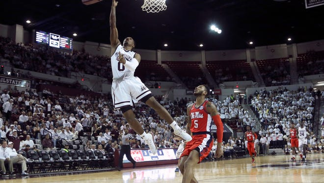 Mississippi State Bulldogs guard Nick Weatherspoon (0) shoots the ball during the first half against Mississippi Rebels guard Markel Crawford (5) at Humphrey Coliseum. Mandatory Credit: Spruce Derden-USA TODAY Sports