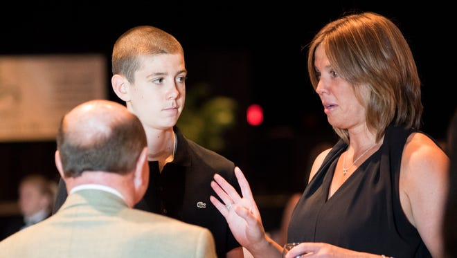 Patrick McCaffery and his mother, Margaret, converse with guests at the 4th Annual Dick Vitale Golf Tournament and Gala held at the Riverside Casino to benefit the V Foundation on June 20, 2014. Patrick had a tumor removed from his thyroid in March.