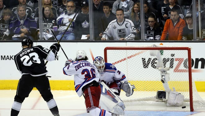 Dustin Brown  of the Los Angeles Kings scores the game-winning goal past Rangers goaltender Henrik Lundqvist  in double overtime to give the Kings a 5-4 victory in  Game 2 and a 2-0 lead in the Stanley Cup Final Saturday night.