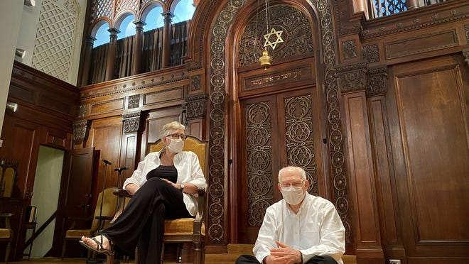 """Rabbi Mark Elber and his wife Cantor Shoshana Brown are seen here on the """"bimah"""" of Temple Beth El in Fall River the day before the start of the Rosh Hashanah holiday."""