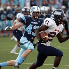 The Brandeis Broncos got a slow start before overtaking the Johnson Jaguars and grabbing a 26-17 victory in the non-district opener for both teams at Heroes Stadium on Friday, Aug. 29, 2014.