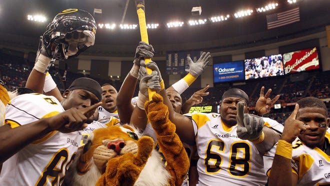 In this file photo, Grambling player celebrate after defeating Southern University in the 2008 Bayou Classic on Saturday, Nov. 29, 2008.