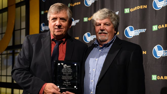Hockey East commissioner Joe Bertagna, left, presents Free Press Correspondent Ted Ryan with the Joe Concannon Media Award on Tuesday at TD Garden in Boston, Massachusetts.