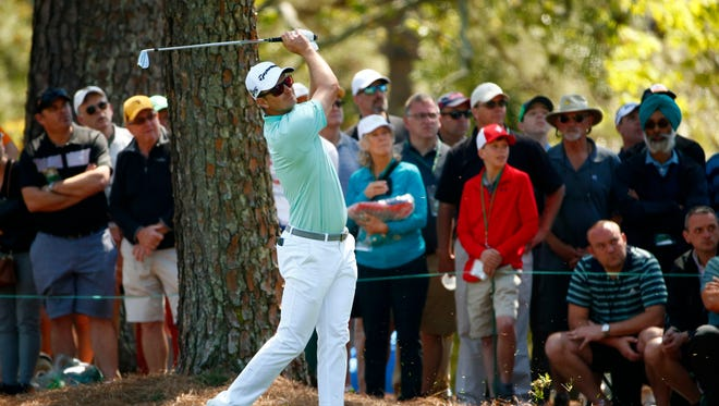 Justin Rose hits from the fairway on the 1st hole during the third round of the Masters on April 8.
