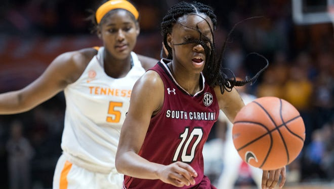 South Carolina's Bianca Jackson chases after the ball while followed by Tennessee's Kamera Harris during an NCAA college basketball game in Knoxville, Tenn., Sunday, Feb. 25, 2018.