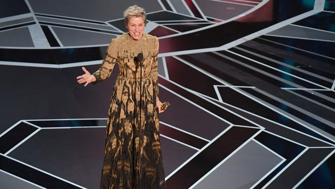 """TOPSHOT - US actress Frances McDormand delivers a speech after she won the Oscar for Best Actress in """"Three Billboards outside Ebbing, Missouri"""" during the 90th Annual Academy Awards show on March 4, 2018 in Hollywood, California. / AFP PHOTO / Mark RALSTONMARK RALSTON/AFP/Getty Images ORIG FILE ID: AFP_11X45L"""