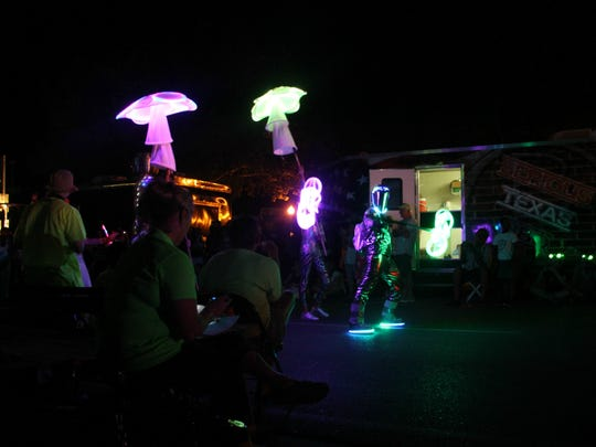 Families gathered for the Alien Light Parade on Saturday.