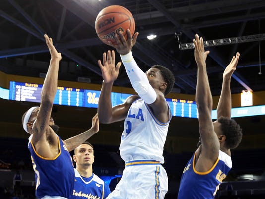 UCLA guard Aaron Holiday (3) shoots against Cal State Bakersfield during the second half of an NCAA college basketball game in Los Angeles on Wednesday, Nov. 29, 2017. UCLA won 75-66. (AP Photo/Reed Saxon)