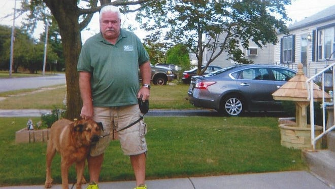 """Lenny Curtis of Paulsboro turned to a pet loss support group after the unexpected death of his 8 1/2-year-old German shepherd mix, Harry. """"I was the magnet; he was like my steel,"""" Curtis said."""