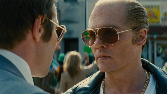 """Joel Edgerton and Johnny Depp appear in a scene from """"Black Mass."""""""