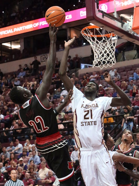 Louisville's Deng Adel shoots as Florida State's Christ Koumadje defends during the second half of an NCAA college basketball game Wednesday, Jan. 10, 2018, in Tallahassee, Fla. Louisville won 73-69. (AP Photo/Steve Cannon)