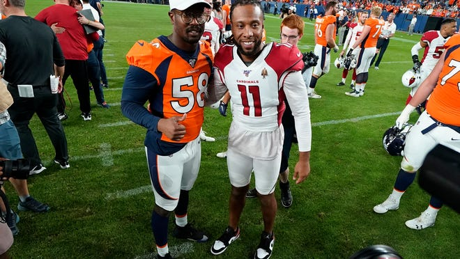 FILE - In this Aug. 29, 2019, file photo, Denver Broncos outside linebacker Von Miller (58) greets Arizona Cardinals wide receiver Larry Fitzgerald (11) after an NFL preseason football game in Denver. The NFL will cut its preseason in half and push back the start of exhibition play so teams have more time to train following an all virtual offseason made necessary by the coronavirus pandemic, a person with knowledge of the decision told The Associated Press. The person spoke on condition of anonymity because the league hasn't announced that the preseason will be cut from four games to two.