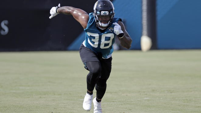 Jacksonville Jaguars running back James Robinson performs a drill during a workout on Aug. 12 in Jacksonville, Fla. The former Lutheran star worked his way to the top of the running back depth chart and will start on Sunday.
