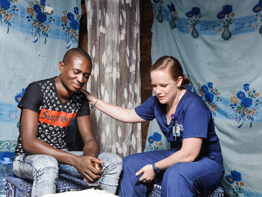 636620901342898766-Jenni-Nelson-Mercy-Ships-prays-with-patient.jpg