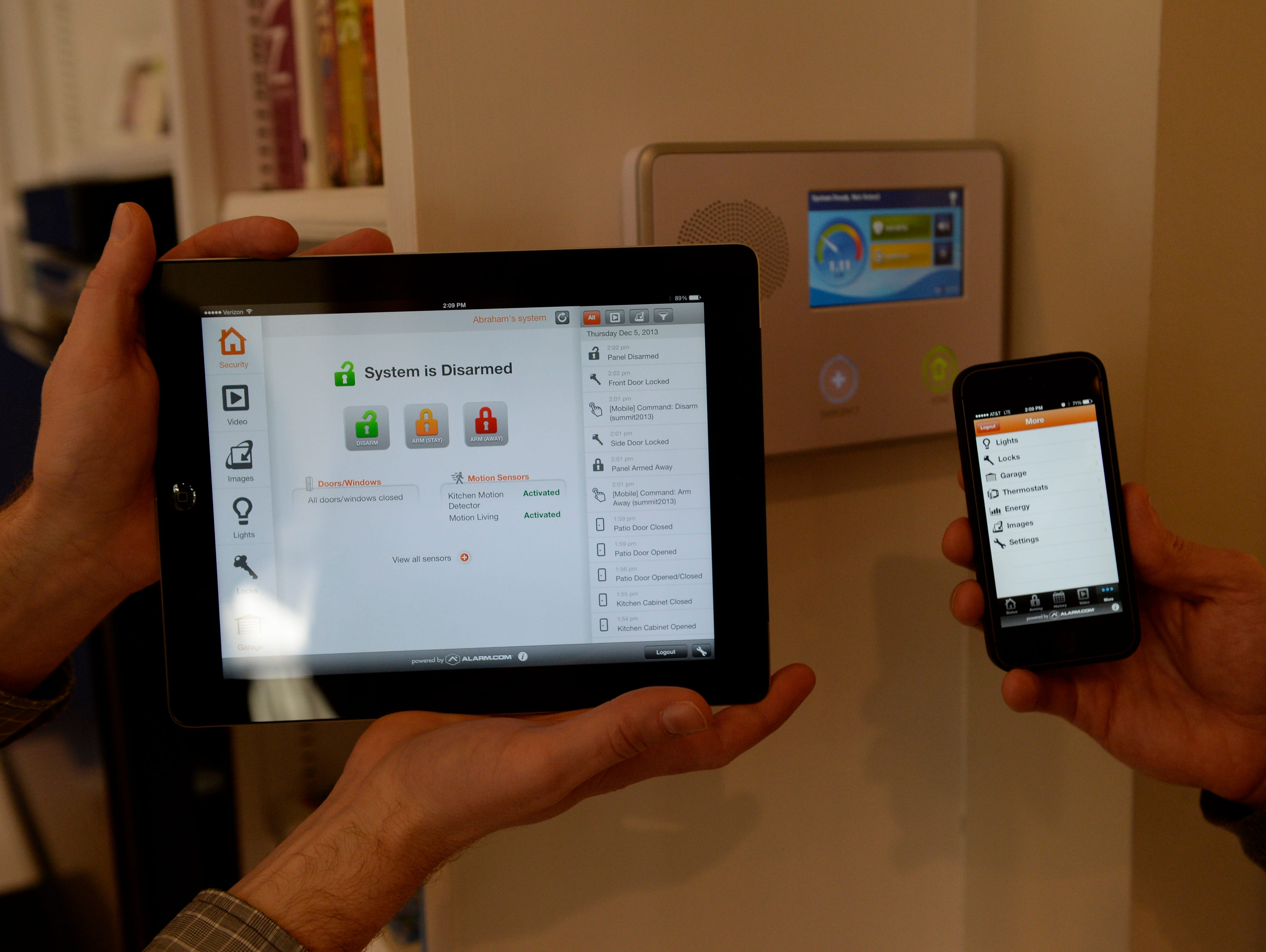 A security system from Alarm.com uses mobile apps to control alarms, lights, thermostats and more.