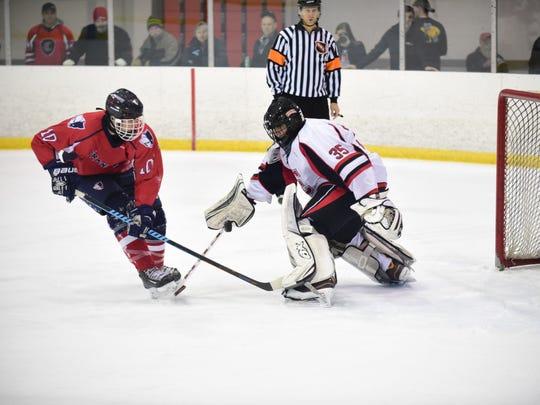 Churchill goalie Chris Sergison denies Franklin's Dakota